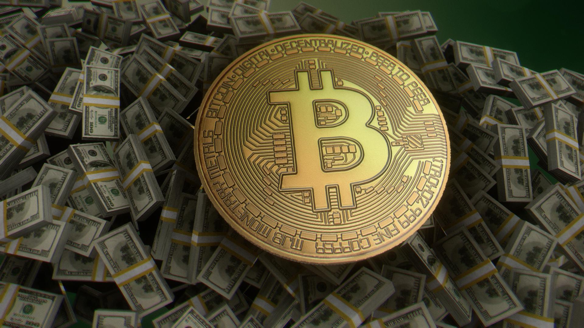 Eine Bitcoin als Goldmünze liegt auf einen Stapel 100-Dollar-Banknoten. Foto: Flying Logos, CC BY-SA 4.0 via Wikimedia Commons